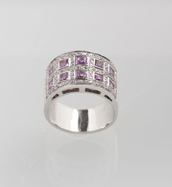 White gold ring with pink sapphires and diamonds
