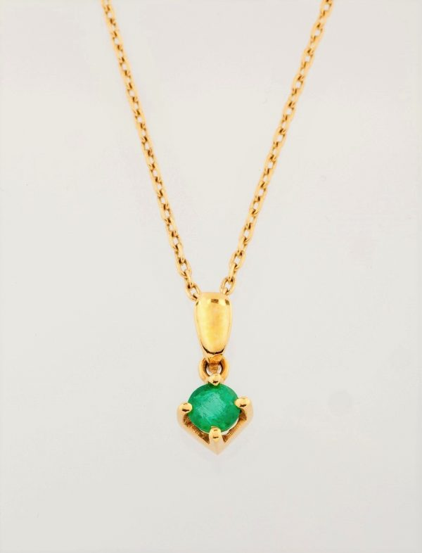 Gold pendant with emerald