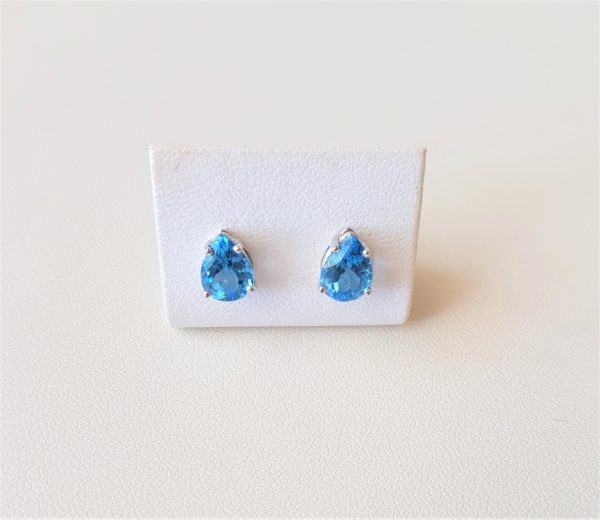 White gold earrings with blue topaz