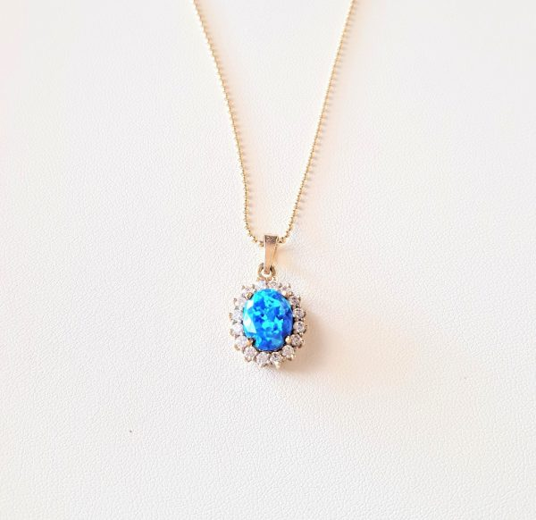Gold pendant with opal and zirconia