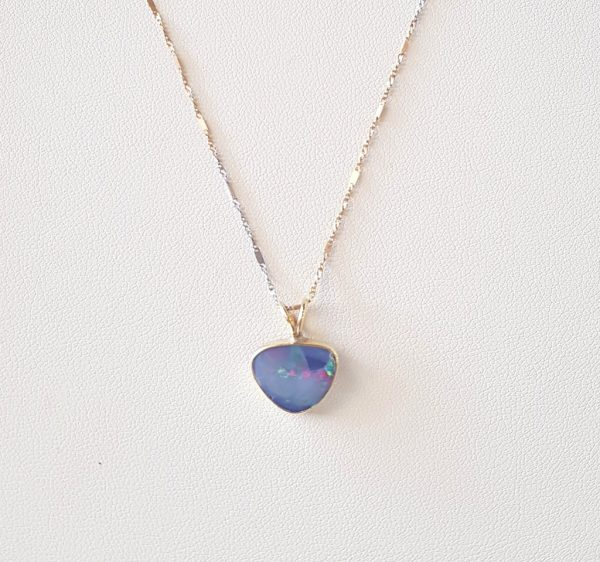 Gold and silver pendant with opal